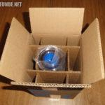Die Flasche in der Verpackung